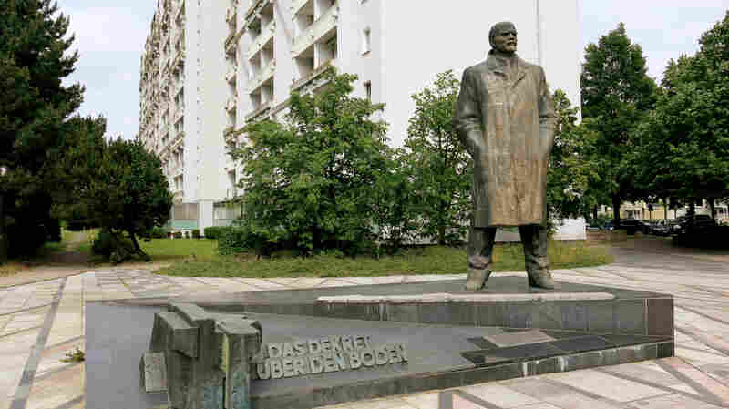 """A statue of Soviet founder Vladimir Lenin outside an apartment complex in Schwerin, Germany. Erected in 1985, four years before communism collapsed in East Germany, it's believed to be the last Lenin statue in Germany and the town is divided over whether it should stay. The inscription reads, """"Decree on land,"""" referring to a Lenin manifesto that said workers were the real owners of the land."""