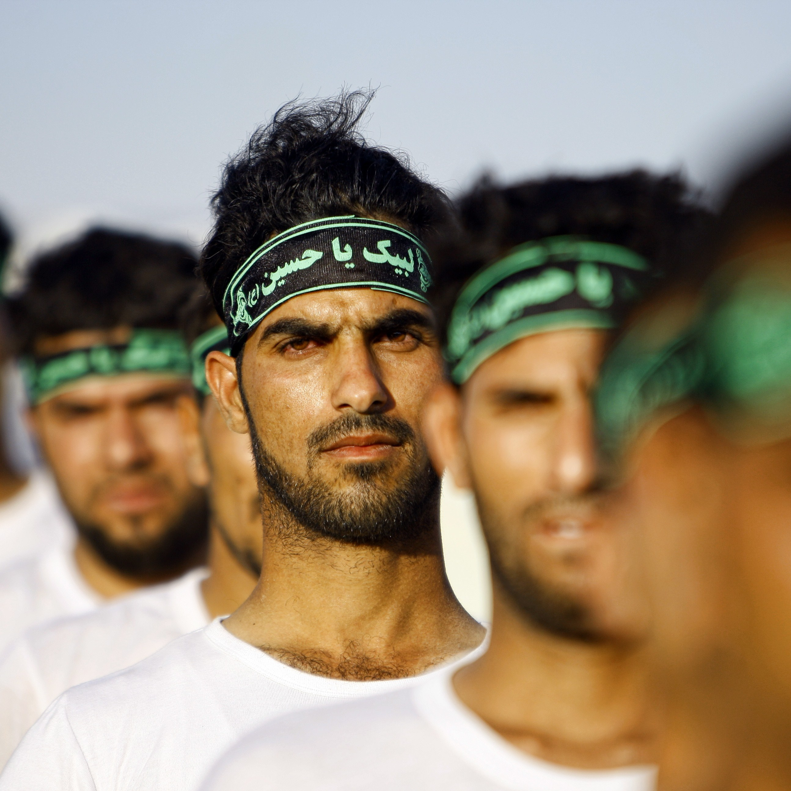 Iraqi Shiite volunteers with the Labayk ya Hussein Brigade take part in a training session in the holy city of Najaf in late June. Clerics in the city called for Shiites to step forward and fight the Sunni group formerly known as the Islamic State of Iraq and Syria (which now calls itself simply the Islamic State).
