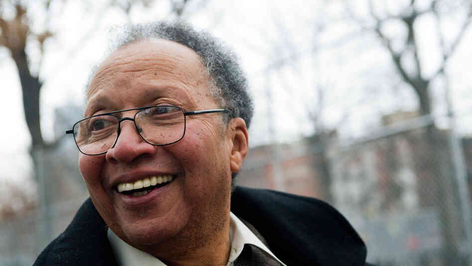 Author Walter Dean Myers tours his old Harlem neighborhood in New York, Dec. 13, 2010.