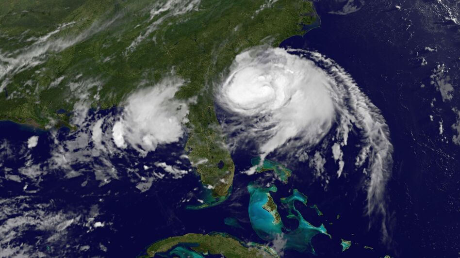 Hurricane Arthur is moving up along the Eastern U.S. coast, bringing complications to July 4 travel and holiday plans. A satellite image shows the storm's position at 5 a.m. ET. (NASA GOES Project)