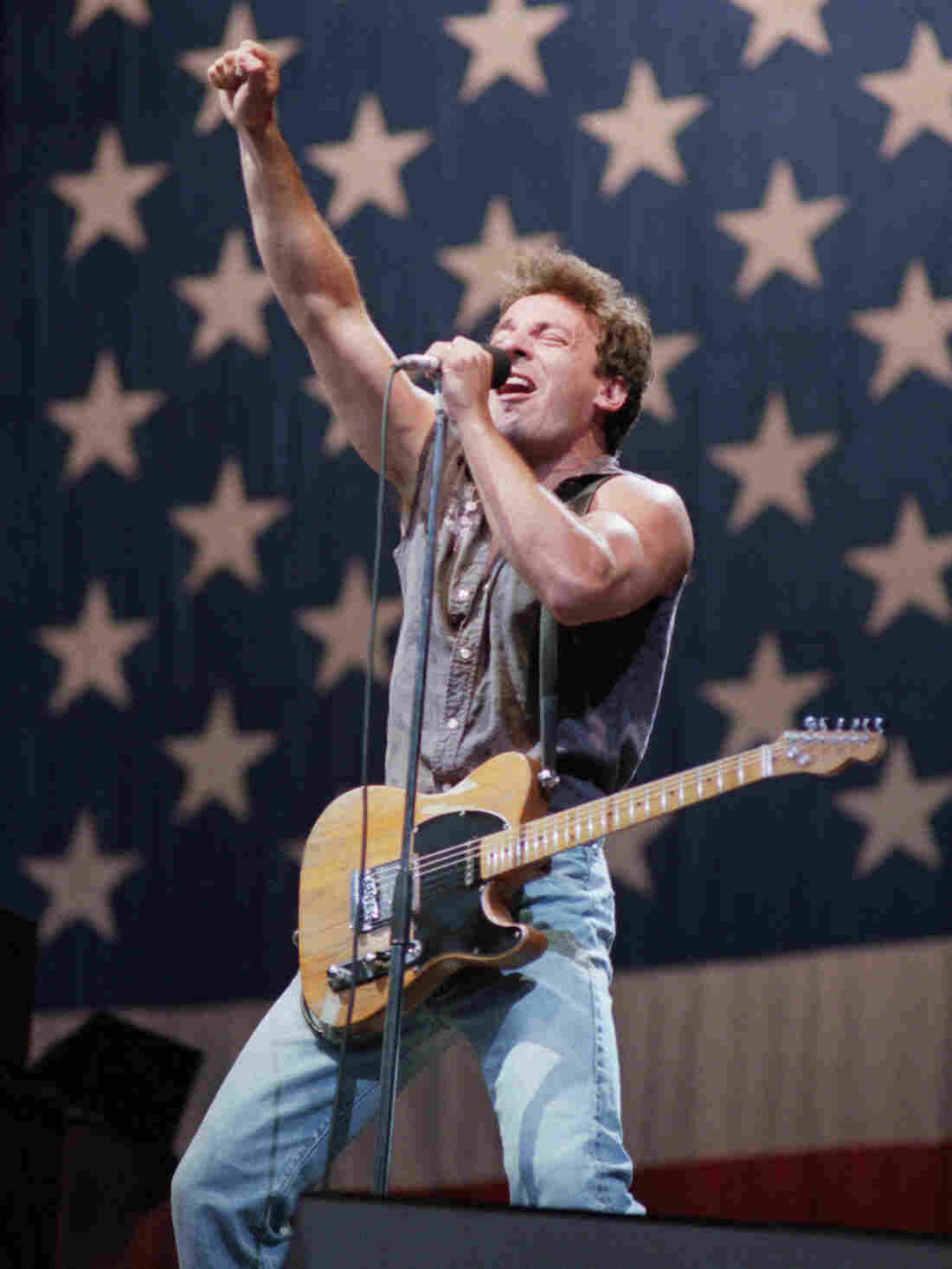 "Bruce Springsteen belts out his hit song ""Born in the USA"" before a sellout crowd as he kicks off his 1985 US tour in Washington, DC."