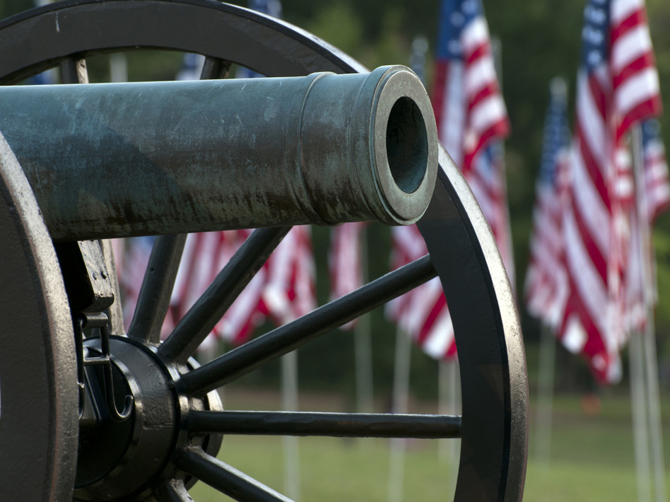 A Civil War cannon with American flags in Kennesaw, Ga.