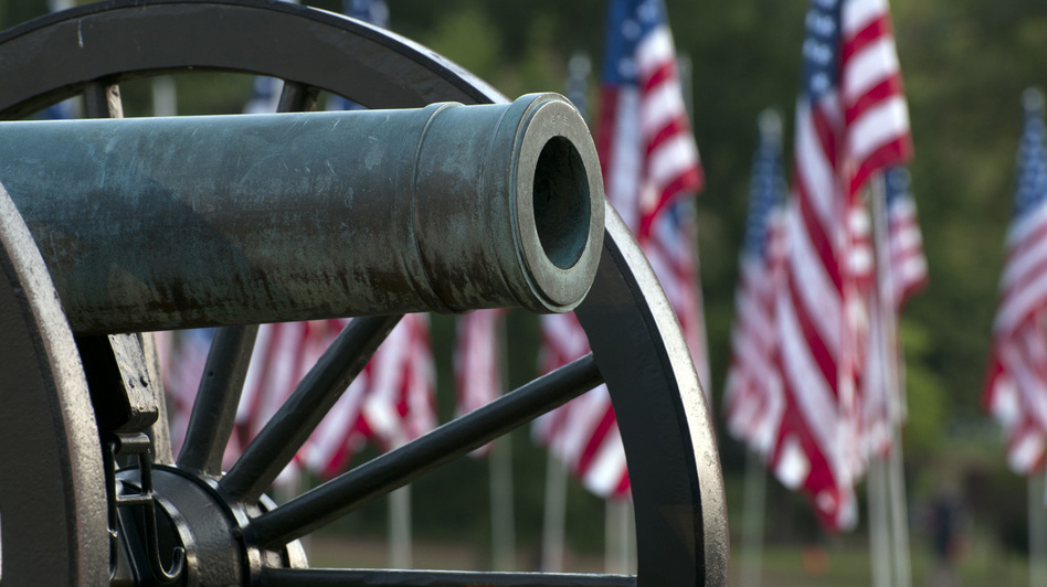 A Civil War cannon with American flags in Kennesaw, Ga. (iStock)
