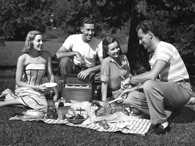 Two couples having a picnic during the '50s.