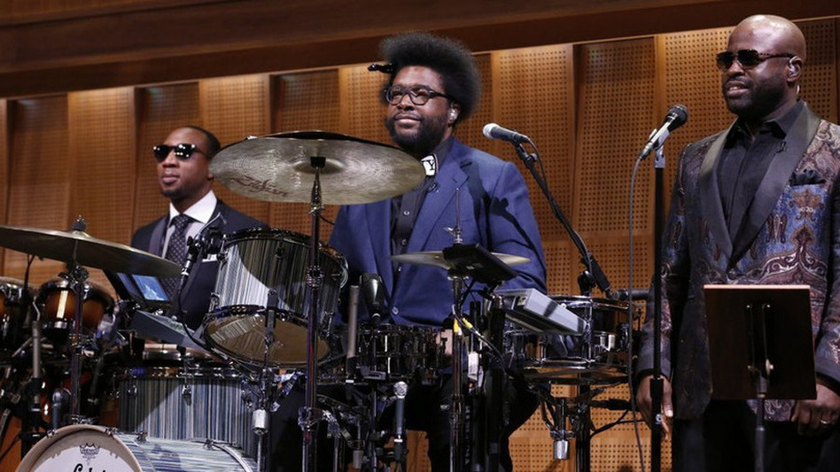 """Ahmir """"Questlove"""" Thompson (center) appears with The Roots members Frank Knuckles (left) and Tariq """"Black Thought"""" Trotter during the first episode of The Tonight Show Starring Jimmy Fallon. (NBC)"""