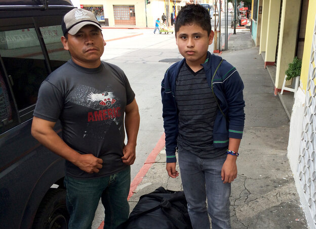 Ezequiel Vazquez and his 15-year-old son, Ilbaro, leave a government-run shelter in Guatemala City. Ilbaro was deported from the U.S. after spending six months in a Texas detention facility. He returned with a U.S.- issued duffel bag full of clothes, shoes, books and toys.
