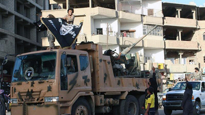 Fighters from the Islamic State hold a parade in Raqqa, in northeastern Syria, displaying equipment captured from the Iraqi army. The group has declared a caliphate, or a single Islamic state, in the parts of Syria and Iraq it controls. This undated image was posted by the Raqqa Media Center, a Syrian opposition group, on Monday.
