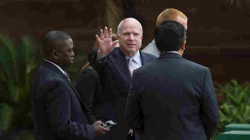 U.S. Sen. John McCain leaves a meeting with India's foreign minister Wednesday in New Delhi.