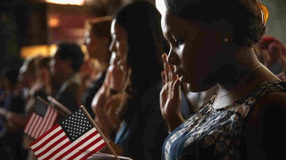 Vishaun Lawrence of Jamaica takes an oath of citizenship during a naturalization ceremony at the Chicago Cultural Center on July 3, 2013 in Chicago, Illinois. The ceremony, which recognized 71 new citizens from 32 countries, was one of more than 100 naturalization ceremonies held across the country and around the world to celebrate Independence Day.