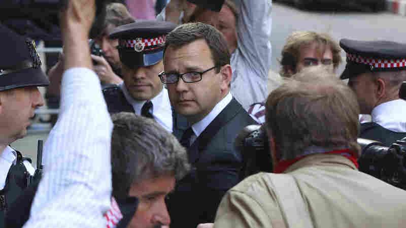 Former News of the World editor Andy Coulson arrives for the sentencing at t