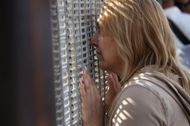 Families communicated through a border fence at San Diego's Friendship Park Nov. 17. On weekends, people on the American side are allowed to to visit, under U.S. Border Patrol supervision, with family and friends in Mexico.