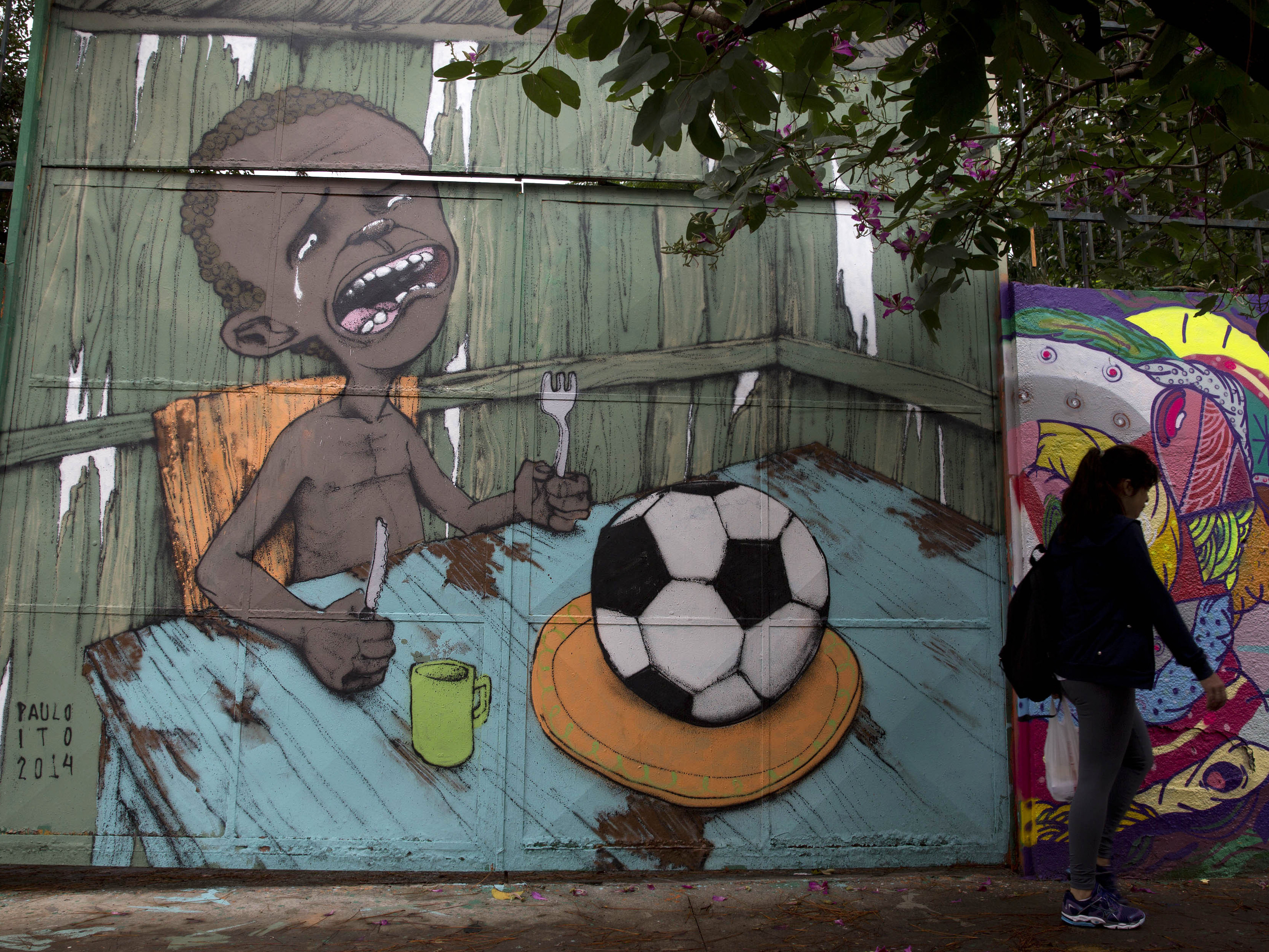 Graffiti Artist Sprays Brazil's Turmoil Across Its City Walls