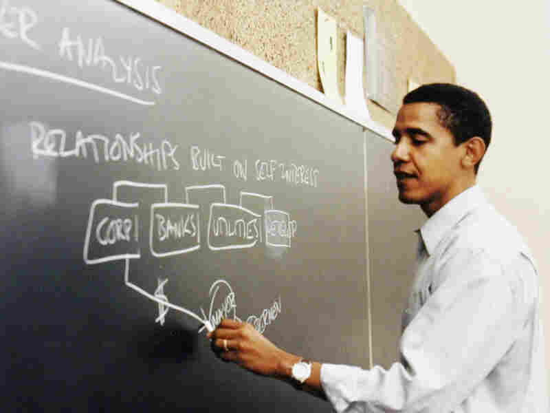 This undated file photo released by Obama for America shows Barack Obama teaching at the University of Chicago Law School in Chicago, where he was a faculty member for more than a decade. The university is contending for his presidential library.