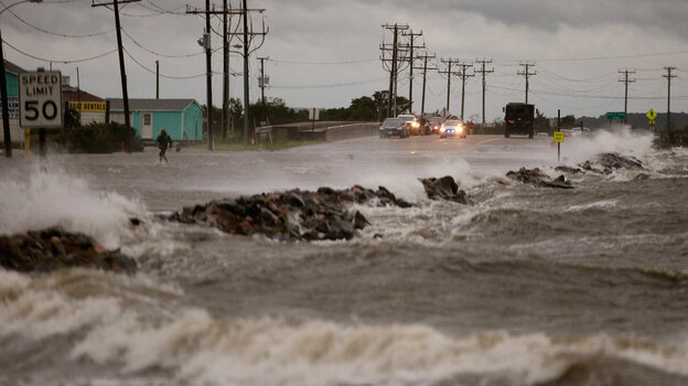 Hurricane Arthur brought strong winds and heavy surf to Highway 64 in Nags Head, N.C., on Thursday.