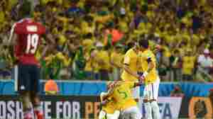 Brazil's players celebrate after winning the World Cup quarter-final football match between Brazil and Colombia on Friday.