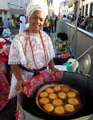 Acaraje vendor Rita Santos and many like her fought FIFA, the World Cup's governing organization, to continue selling the traditional food outside Brazil's stadiums.