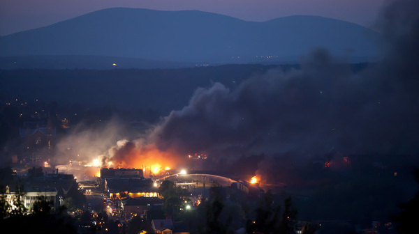 Firefighters douse blazes after a freight train loaded with oil derailed in Lac-Megantic, Quebec, last July.