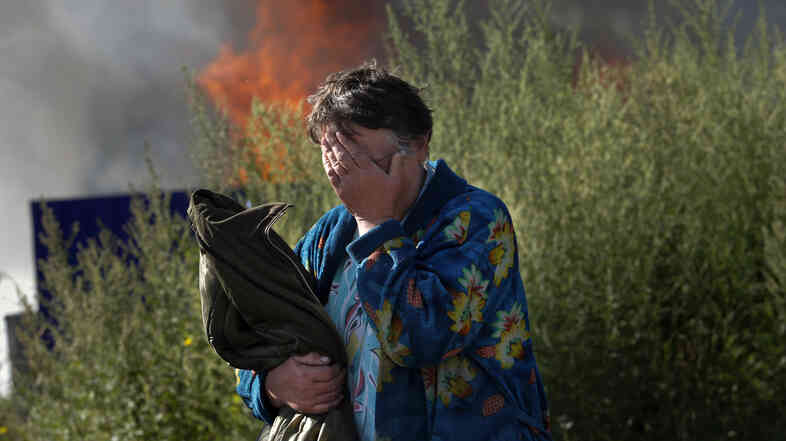 A woman cries near her burning house after shelling in the city of Slovyansk, Donetsk Region, eastern Ukraine, last month. The city of 100,000 has now been retaken from pro-Russian separatists.