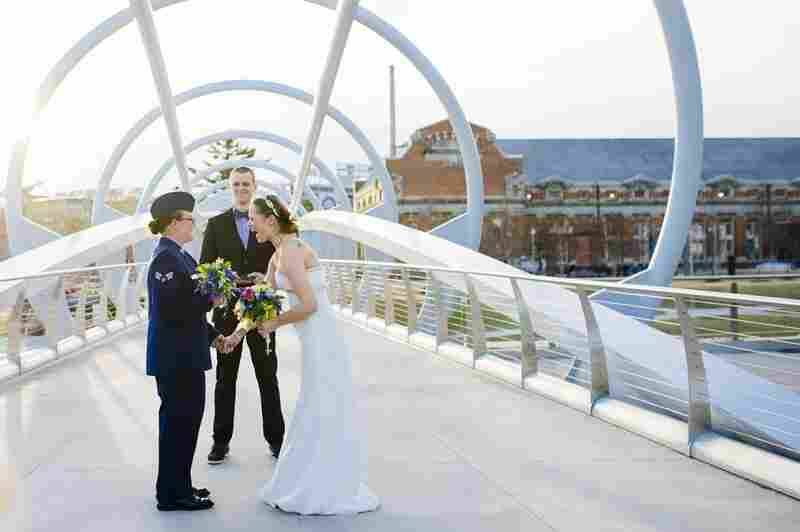 Michelle Sharp (left) and Megan Huff have their ceremony along a unique bridge in Yards Park near the Navy Yard.