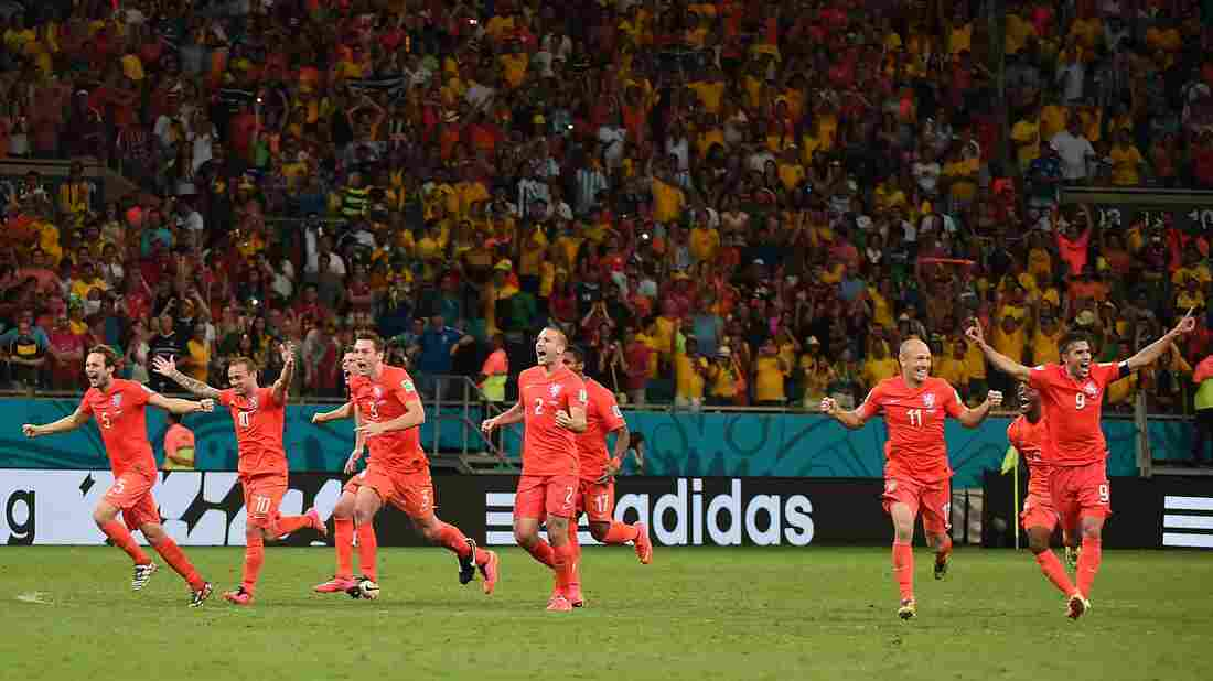 Netherlands' footballers celebrate after defeating Costa Rica during the penalty shootout after the extra time in the World Cup quarterfinal football match between Netherlands and Costa Rica on Saturday.
