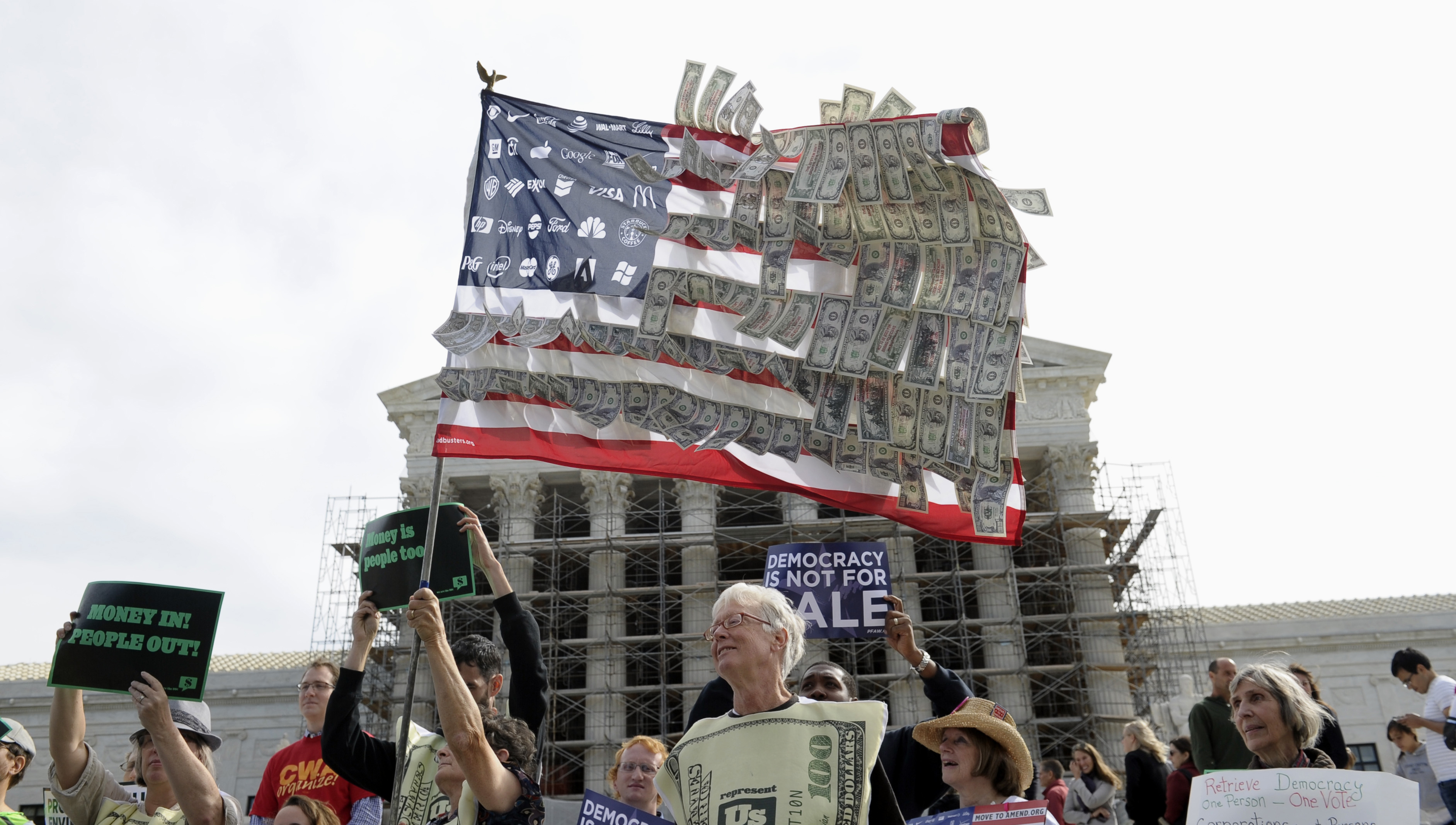 Demonstrators gather outside the Supreme Court on Oct. 8, 2013, as the court hears arguments on campaign finance. The court ultimately struck down a cap on contributions to political parties in each election.
