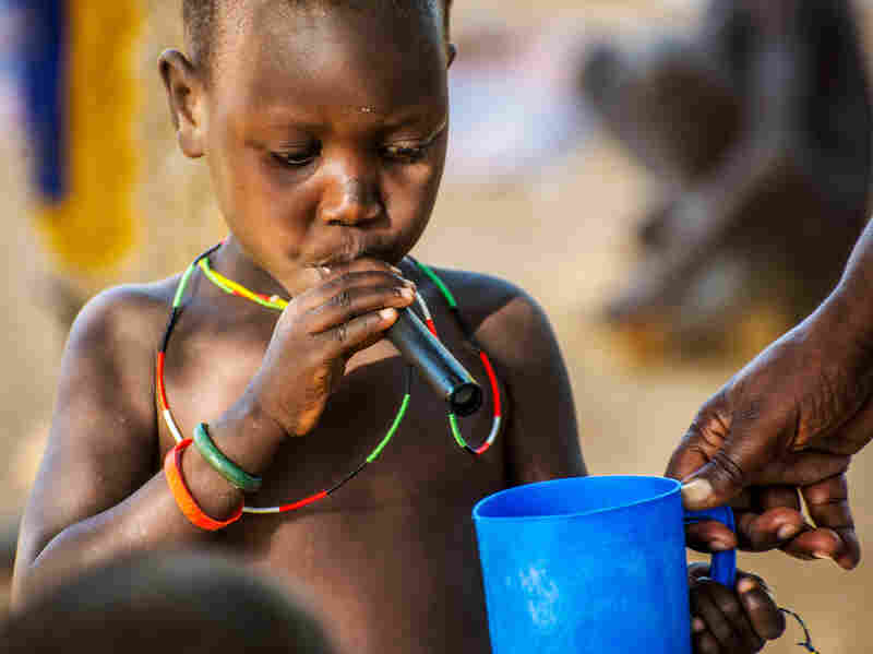 A kid learns that drinking water through a filtered straw can prevent Guinea worm. Twelve of the 17 Guinea worm cases in 2014 have occurred in South Sudan's Eastern Equatoria State, where this child lives.