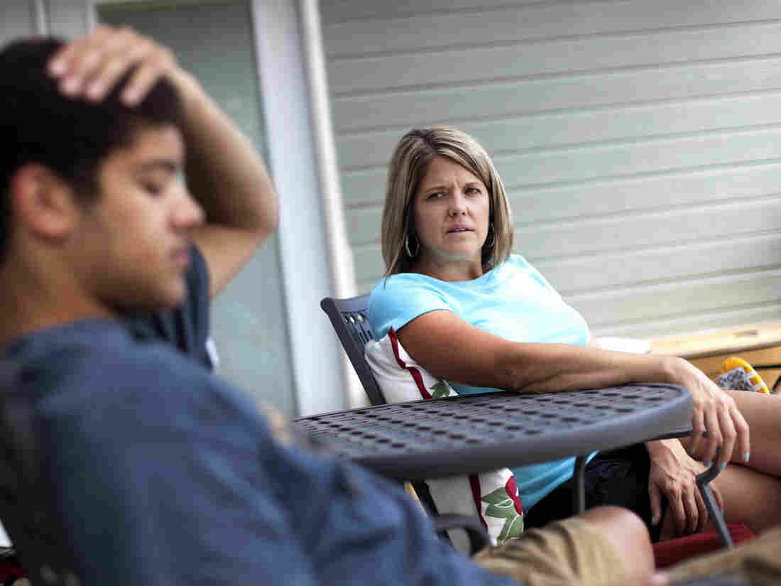 Amy Myers talks with her son Kamron, 18, in the backyard of their home in Boise, Idaho. She has found raising a teenager to be extremely stressful.