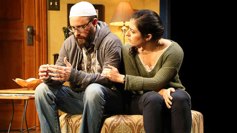 Between Eli and Zarina (Greg Keller and Nadine Malouf), a family's Muslim faith undergoes rupture and renewal.