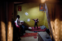 Sisay hits a balloon toward his sister, Tseget, at their home last May. Sisay hardly leaves his neighborhood except for school, which is a 10-minute walk.