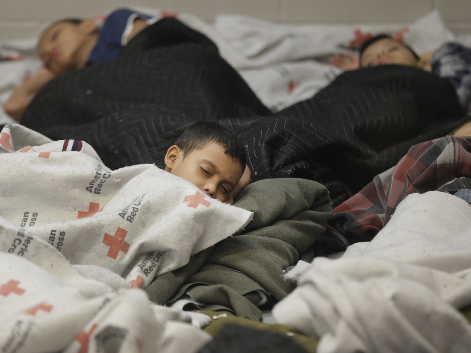 Detainees sleep in a holding cell at a U.S. Customs and Border Protection processing facility in Brownsville, Texas, on June 18. The White House on Tuesday sought $3.7 billion to deal with the immigration crisis at the border. (Eric Gay/AP)