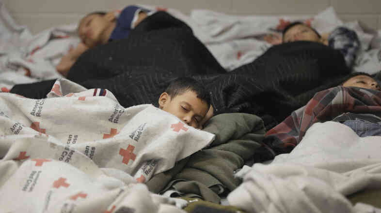 Detainees sleep in a holding cell at a U.S. Customs and Border Protection processing facility in Brownsville, Texas, on June 18. The White House on Tuesday sought $3.7 billion to deal