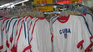 Serafin Blanco's discounted clothing store in Hialeah advertises its cheap deals. Cuban customers take their purchases back to Cuba to give to relatives or to sell, Blanco says.