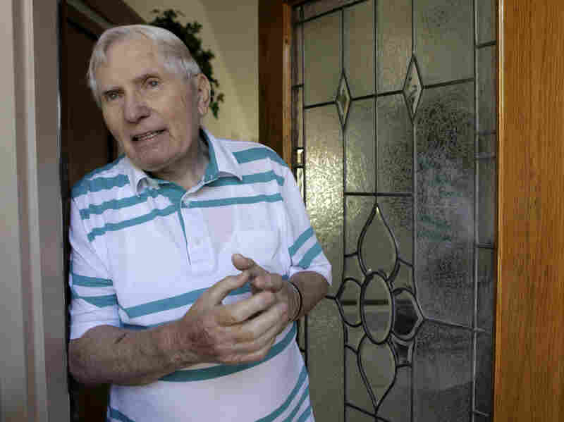 John Kalymon talks to The Associated Press in 2009 outside his home in Troy, Mich. Kalymon died June 29.