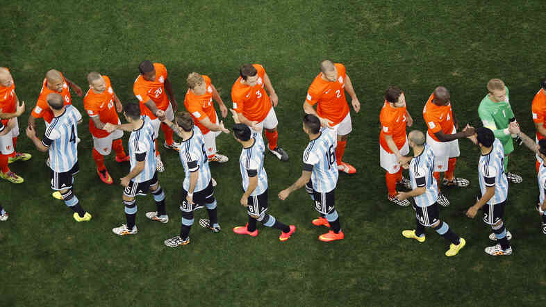 Argentine and Dutch players greet each other prior to their World Cup semifinal soccer match at the Itaqu