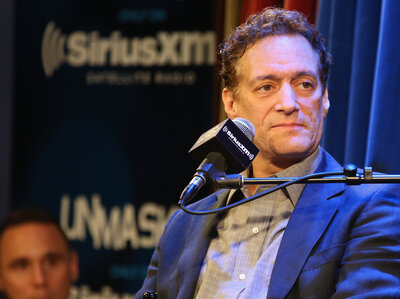 Anthony Cumia, at an April event commemorating 20 years of The Opie & Anthony Show, was fired after a series of racially charged tweets.