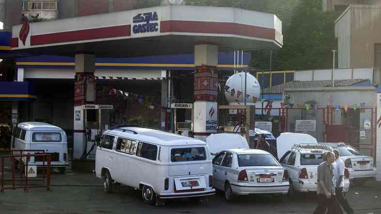 Egyptians gather at a petrol station in Cairo as the government drastically raised fuel prices to tackle a bloated subsidy system on July 5.