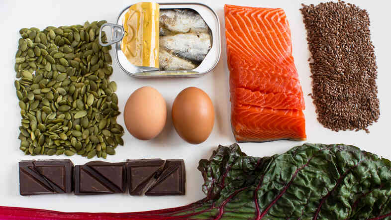 A nutrient-dense diet may help tamp down stress. And these foods may help boost our moods: (Clockwise from left) pumpkin seeds, anchovies, eggs, salmon, flax seeds, Swiss chard and dark chocolate.