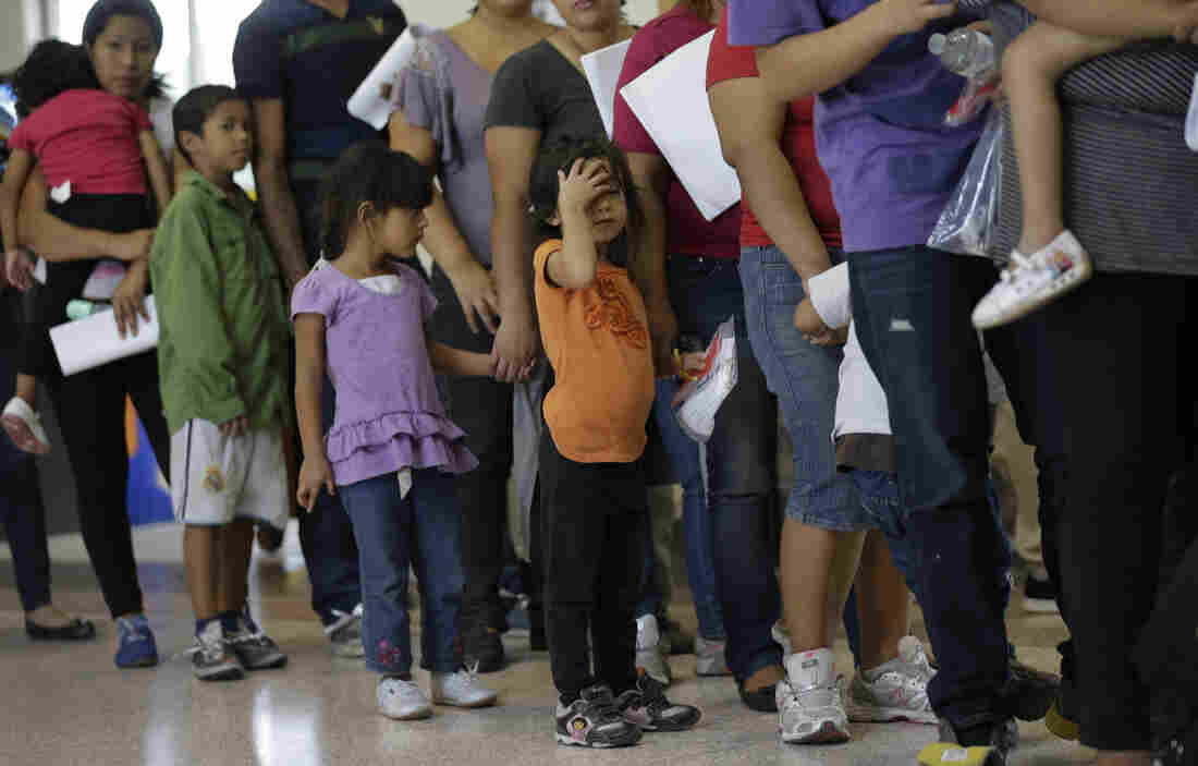 Immigrants who entered the U.S. illegally stand in line for bus tickets after their release in June from a U.S. Customs and Border Protection processing facility in McAllen, Texas.