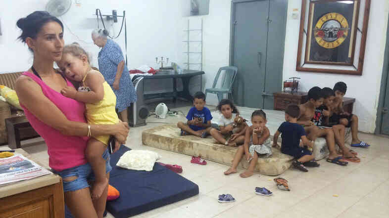 Several families share this one-room underground shelter in Ashkelon, Israel, not far from the border with Gaza. The children say they're afraid to go outside.