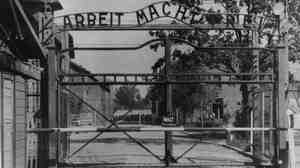 """The main gate of the Nazi concentration camp Auschwitz I in Poland, where Johann """"Hans"""" Breyer served as a guard."""