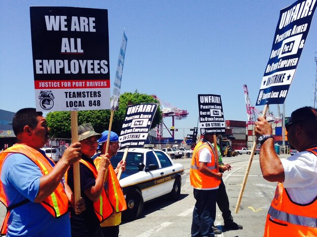 Picketers supporting independent truck drivers