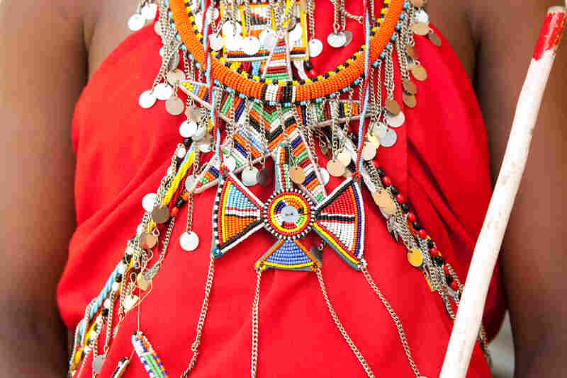 The Maasai wear vibrant colored shukas, or robes, adorned with elaborate beaded jewelry made by the women.