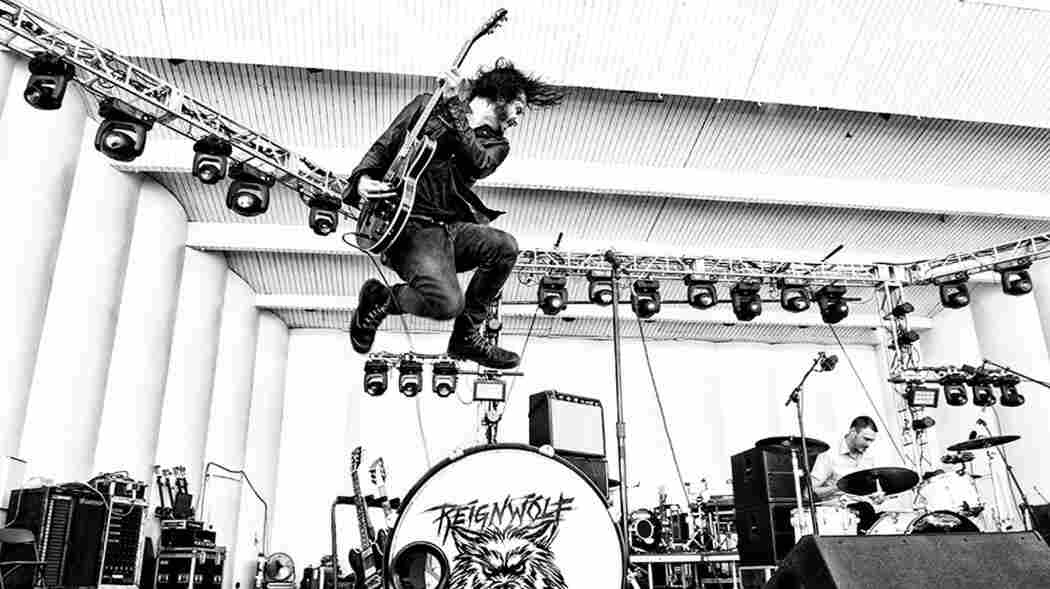 If you look closely, Reignwolf's guitar is plugged in. Newport's 1965 crowd would not be pleased.