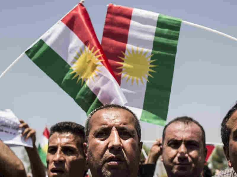 Iraqi Kurds call for independence as Masud Barzani, president of Iraq's autonomous Kurdistan region, arrives to attend a session of the Kurdish Parliament on July 3.