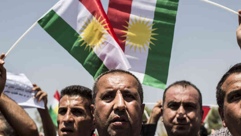 Iraqi Kurds call for independence as Masud Barzani, president of Iraq's autonomous Kurdistan region, arrives to attend a session of the Kurdish Parliament on July 3.