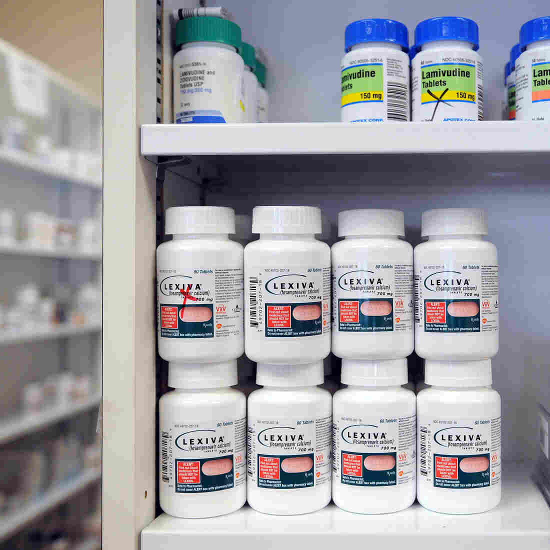 AIDS drugs line a pharmacy's shelves. A new recommendation from the World Health Organization suggests a daily anti-HIV pill for men who have sex with men.