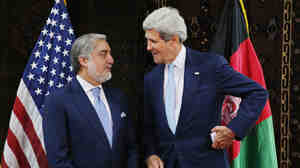 U.S. Secretary of State John Kerry talks