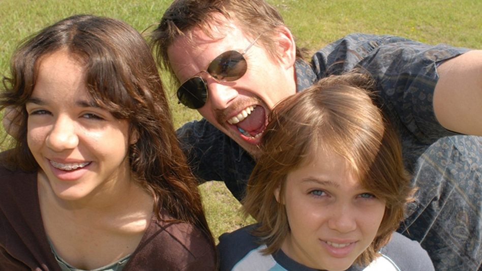 Ellar Coltrane — pictured here with screen family Ethan Hawke and Lorelei Linklater — grows from boy to man on-screen in Richard Linklater's new <em>Boyhood.</em>