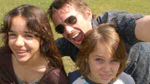 Eller Coltrane — pictured here with screen family Ethan Hawke and Lorelei Linklater — grows from boy to man on-screen in Richard Linklater's new Boyhood.