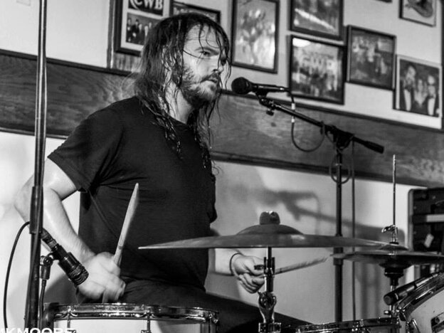Daniel Cundiff, drummer for the Roanoke rock band Eternal Summers, working up a sweat during a live performance.